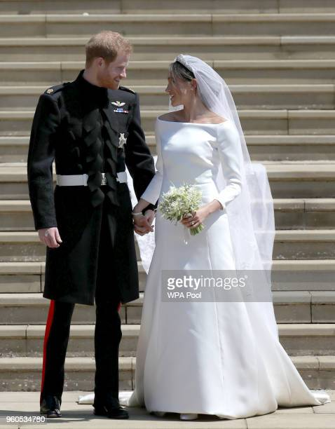 Prince Harry, Duke of Sussex and the Duchess of Sussex depart after their wedding ceremonyat St George's Chapel at Windsor Castle on May 19, 2018 in...