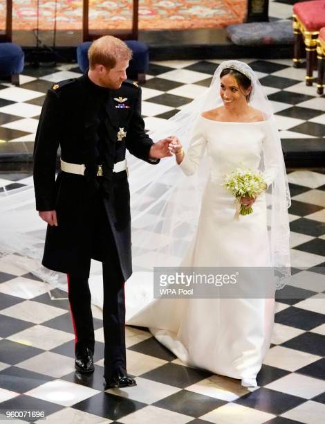 Prince Harry Duke of Sussex and The Duchess of Sussex depart following their wedding in St George's Chapel at Windsor Castle on May 19 2018 in...