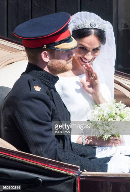 Prince Harry Duke of Sussex and the Duchess of Sussex get into the Ascot Landau Carriage after their wedding ceremony at St George's Chapel Windsor...