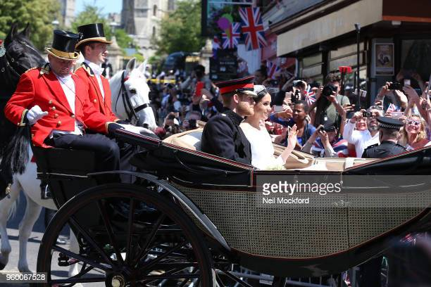 Prince Harry Duke of Sussex and the Duchess of Sussex in the Ascot Landau carriage during the procession after getting married at St Georges Chapel...