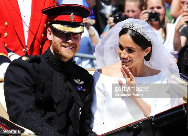 Prince Harry, Duke of Sussex and the Duchess of Sussex in the Ascot Landau carriage during the procession after getting married St George's Chapel,...