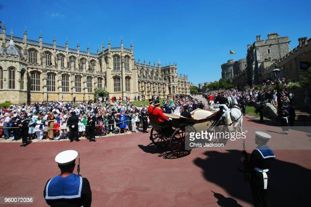 Prince Harry Duke of Sussex and the Duchess of Sussex in the Ascot Landau carriage during the procession after getting married St George's Chapel...