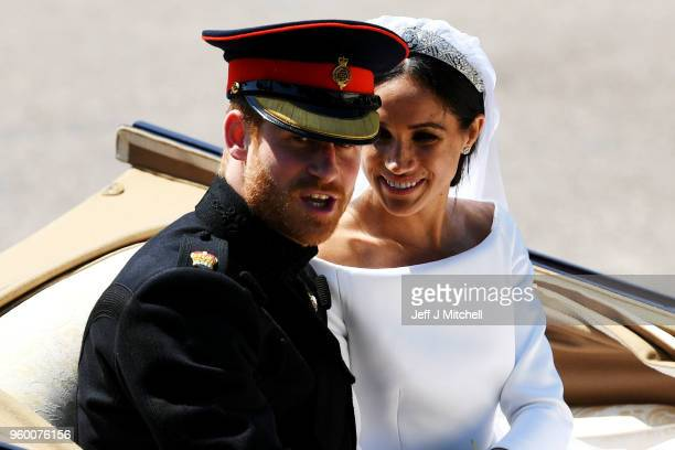 Prince Harry, Duke of Sussex and the Duchess of Sussex in the Ascot Landau carriage during the procession on The Long Walk after getting married St...