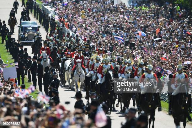 Prince Harry Duke of Sussex and the Duchess of Sussex in the Ascot Landau carriage during the procession on The Long Walk after getting married St...