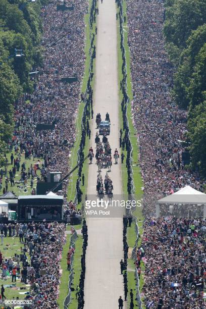 Prince Harry, Duke of Sussex and the Duchess of Sussex in the Ascot Landau Carriage as their carriage procession rides along the Long Walk, on May...