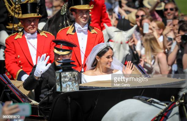 Prince Harry Duke of Sussex and the Duchess of Sussex in the Ascot Landau carriage during the procession after their marriage St George's Chapel on...