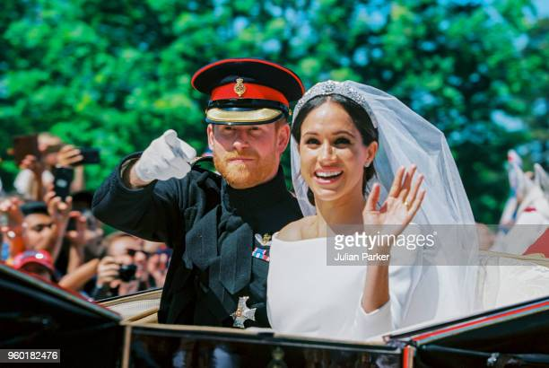Prince Harry Duke of Sussex and the Duchess of Sussex in the Ascot Landau carriage during the procession after getting married at St George's Chapel...