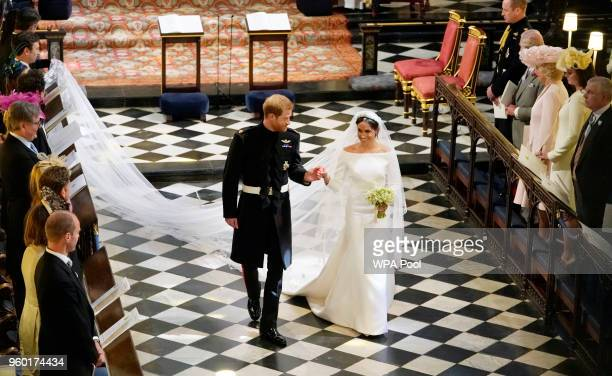 Prince Harry Duke of Sussex and The Duchess of Sussex leave following their wedding ceremony in St George's Chapel at Windsor Castle on May 19 2018...