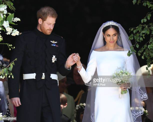 Prince Harry, Duke of Sussex and The Duchess of Sussex leave St George's Chapel, Windsor Castle after their wedding ceremony on May 19, 2018 in...