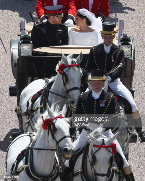 Prince Harry, Duke of Sussex and The Duchess of Sussex leave Windsor Castle in the Ascot Landau carriage during a procession after getting married at...