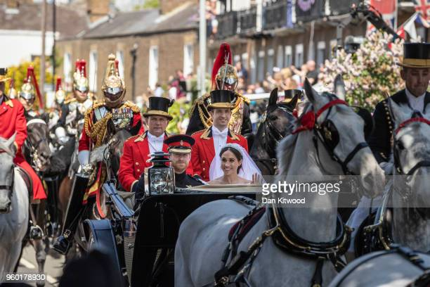 Prince Harry, Duke of Sussex and the Duchess of Sussex process through Windsor in the Ascot Landau carriage after getting married at St Georges...