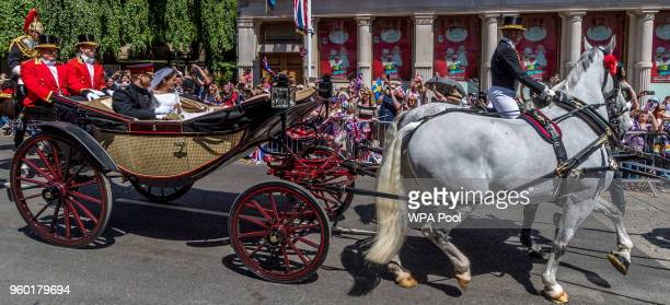 Prince Harry Duke of Sussex and the Duchess of Sussex process through Windsor in the Ascot Landau carriage after getting married at St Georges Chapel...