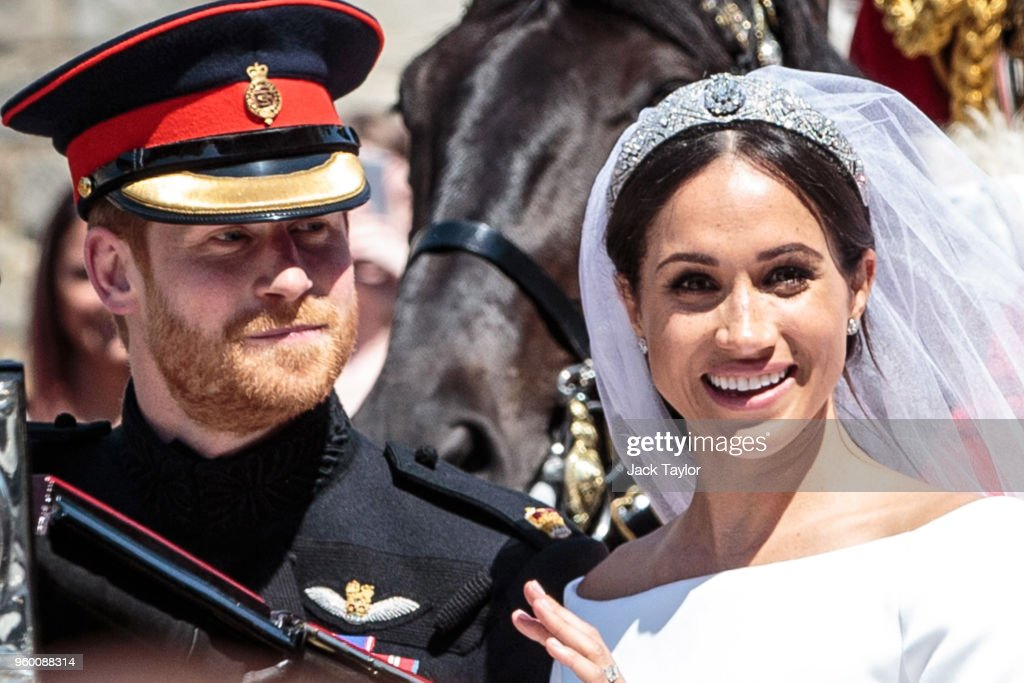 Prince Harry, Duke of Sussex and the Duchess of Sussex ride in the Ascot Landau carriage during the procession after getting married at St George's Chapel, Windsor Castle on May 19, 2018 in Windsor, England. Prince Henry Charles Albert David of Wales marries Ms. Meghan Markle in a service at St George's Chapel inside the grounds of Windsor Castle. Among the guests were 2200 members of the public, the royal family and Ms. Markle's Mother Doria Ragland.