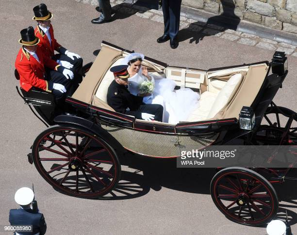 Prince Harry Duke of Sussex and The Duchess of Sussex ride in the Ascot Landau carriage through Windsor Castle after their wedding at St George's...