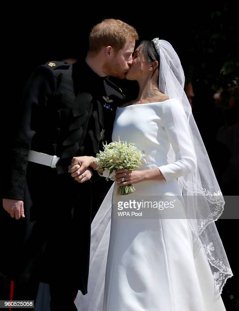 Prince Harry Duke of Sussex and The Duchess of Sussex share a kiss after their wedding at St George's Chapel at Windsor Castle on May 19 2018 in...