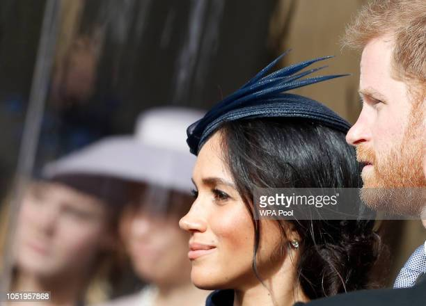 Prince Harry Duke of Sussex and wife Meghan Duchess of Sussex wait for the bridal procession after the wedding of Princess Eugenie of York and Mr...
