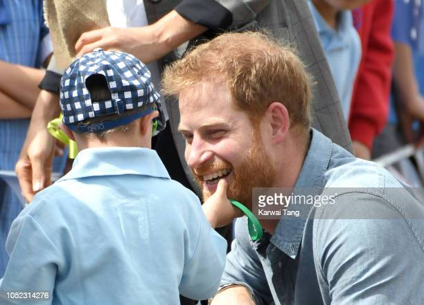 Prince Harry Duke of Sussex arrives at Dubbo airport and is greeted by 5 year old Luke Vincent on October 17 2018 in Dubbo Australia The Duke and...