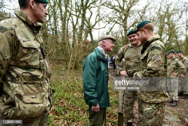 Prince Harry Duke of Sussex Captain General Royal Marines chats to 96 year old former World War 2 Marine Knocker White during his visit to 42...
