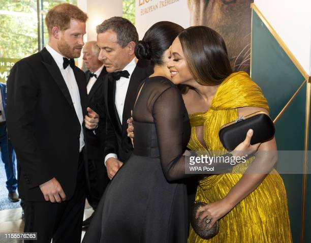 Prince Harry Duke of Sussex chats with Disney CEO Robert Iger as Meghan Duchess of Sussex embraces Beyonce KnowlesCarter as they attend the European...
