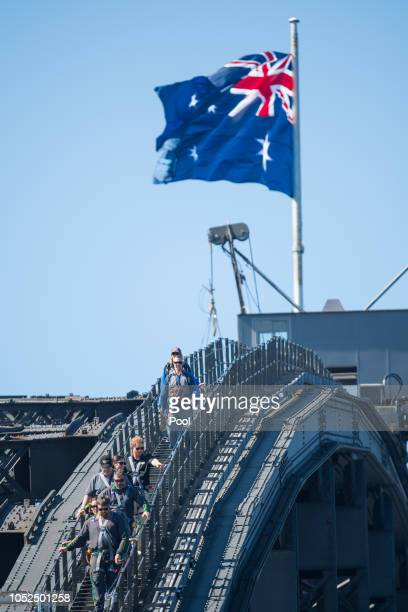 Prince Harry Duke of Sussex climbs the Sydney Harbour Bridge with Prime Minister of Australia Scott Morrison and Invictus Games competitors on...