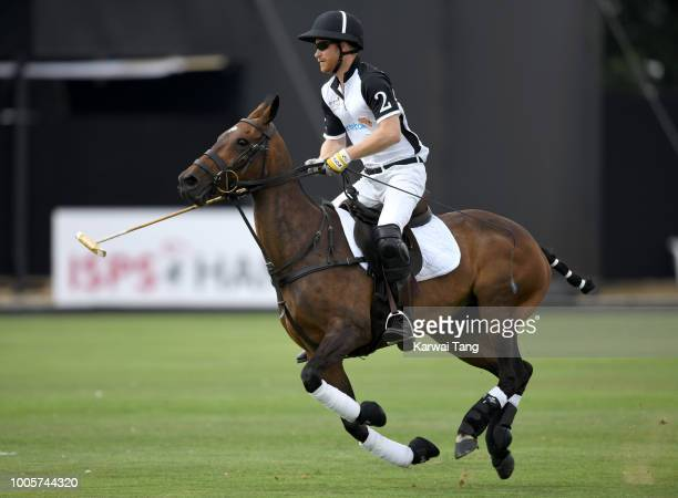 Prince Harry Duke of Sussex competes in the Sentebale ISPS Handa Polo Cup at the Royal County of Berkshire Polo Club on July 26 2018 in Windsor...