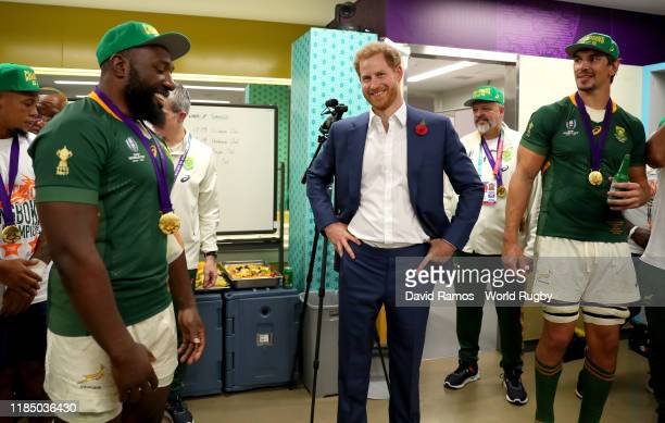 Prince Harry Duke of Sussex congratulates enters the South African dressing room following the Rugby World Cup 2019 Final between England and South...