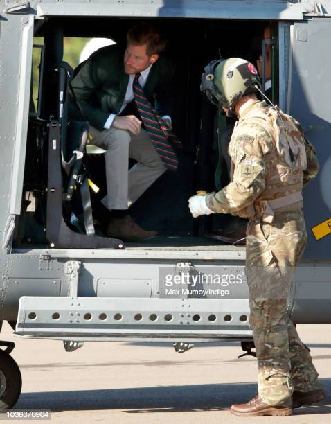 Prince Harry Duke of Sussex disembarks a Royal Navy Wildcat Maritime Attack Helicopter as he arrives for a visit to The Royal Marines Commando...