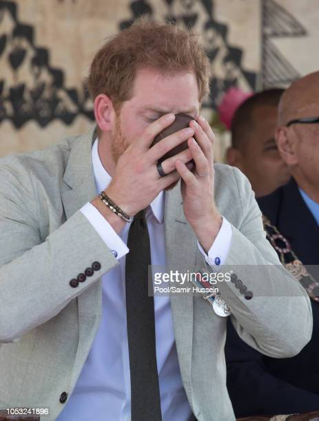 Prince Harry Duke of Sussex drinks kava as he attends the unveiling of the Labalaba Statue on October 25 2018 in Nadi Fiji The Duke and Duchess of...
