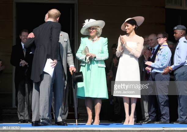 Prince Harry Duke of Sussex embraces his father Prince Charles Prince of Wales as they attend with Camilla Duchess of Cornwall and Meghan Duchess of...