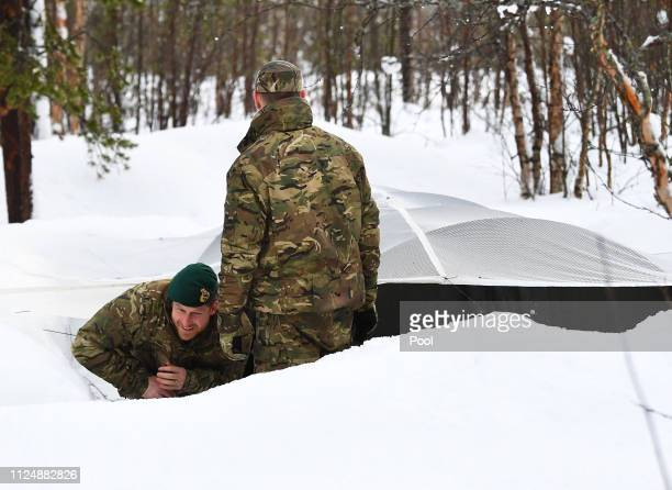 Prince Harry Duke of Sussex exits a Quincey Shelter a makeshift shelter built of snow during a visit to Exercise Clockwork in Bardufoss Norway for a...