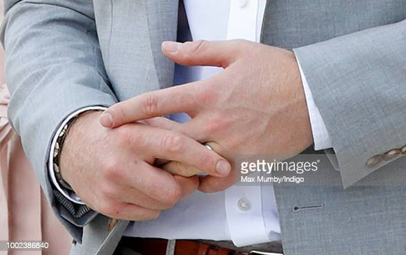 Prince Harry Duke of Sussex fiddles with his wedding ring as he visits The Nelson Mandela Centenary Exhibition at the Southbank Centre on July 17...