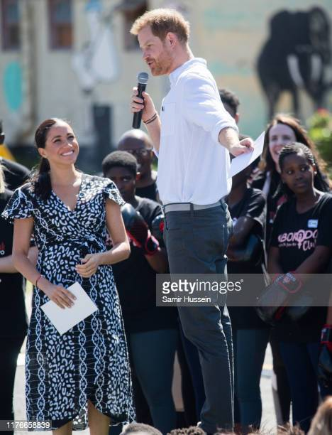 Prince Harry Duke of Sussex gives a speech as he visits the Nyanga Township with Meghan Duchess of Sussex during their royal tour of South Africa on...