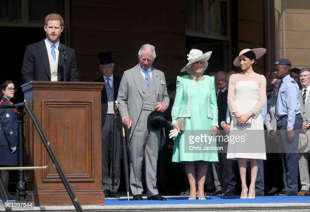 Prince Harry Duke of Sussex gives a speech next to Prince Charles Prince of Wales Camilla Duchess of Cornwall and Meghan Duchess of Sussex as they...