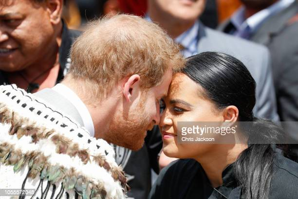 Prince Harry, Duke of Sussex greeting locals in a traditional 'hongi' at the formal pØwhiri and luncheon held at Te Papaiouru Marae on October 31,...
