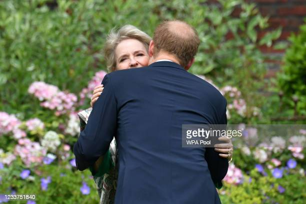 Prince Harry, Duke of Sussex greets Julia Samuel, founder of Child Bereavement UK during the unveiling of a statue of Diana, Princess of Wales, in...