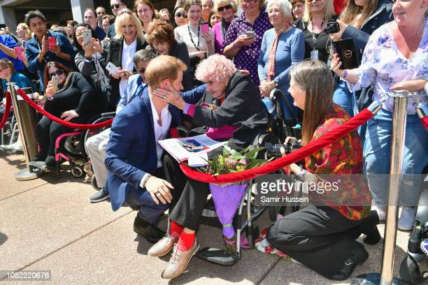 Prince Harry Duke of Sussex greets royal fan and war widow Daphne Dunne at the Sydney Opera House on October 16 2018 in Sydney Australia The Duke and...
