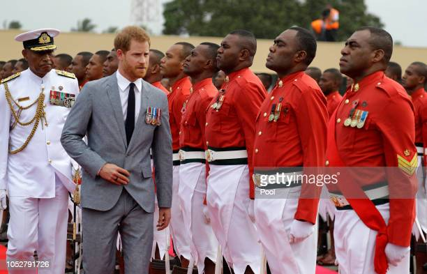 Prince Harry Duke of Sussex inspects a guard of honour at his official welcome ceremony in Suva on October 23 2018 in Suva Fiji The Duke and Duchess...