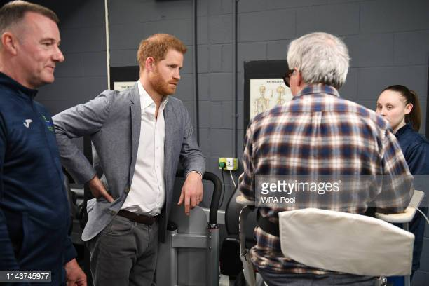 Prince Harry Duke of Sussex interacts with a participant of the Rebound Therapy session as he visits the OXSRAD Disability Sports and Leisure Centre...