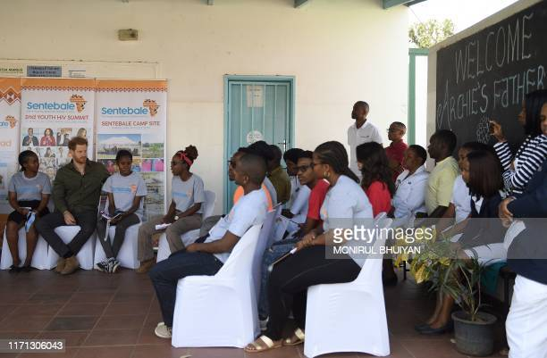 Prince Harry Duke of Sussex interacts with children at The Princes' foundation for children in Africa Sentebale at the Chobe district in the Northern...