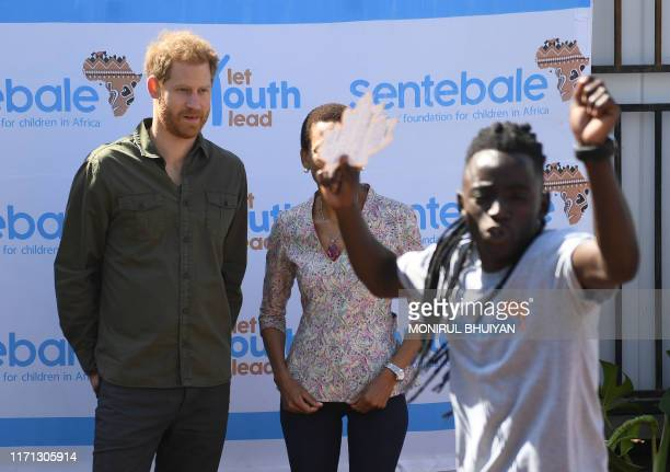 Prince Harry Duke of Sussex interacts with the children at The Princes' foundation for children in Africa Sentebale at the Chobe district in the...