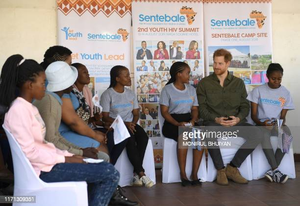 Prince Harry Duke of Sussex interacts with the children at The Princes foundation for children in Africa Sentebale at the Chobe district in the...
