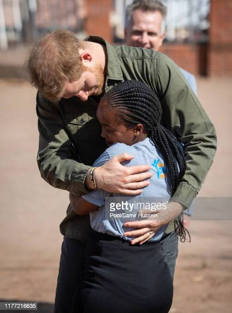Prince Harry Duke of Sussex is greeted by Tlotlo Moilwa during a visit to the Kasane Health Post run by the Sentebale charity on September 26 2019 in...