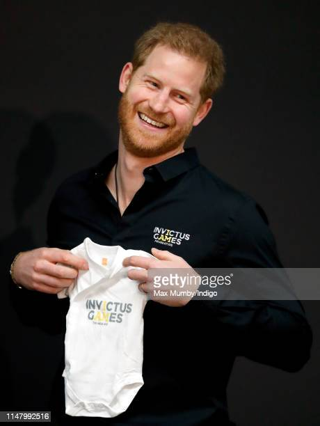Prince Harry Duke of Sussex is presented with an Invictus Games baby grow for his newborn son Archie as he visits Sportcampus Zuiderpark as part of a...
