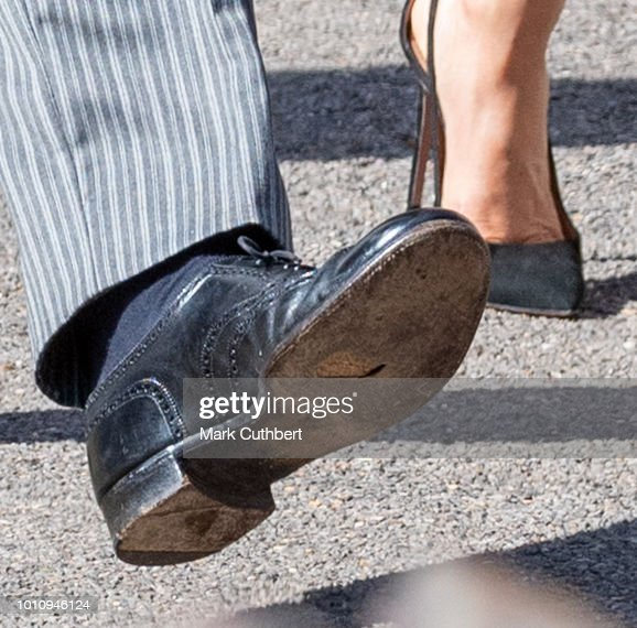 Prince Harry, Duke of Sussex, is seen with a hole in his shoe attends the wedding of Charlie Van Straubenzee and Daisy Jenks on August 4, 2018 in Frensham, United Kingdom. Prince Harry attended the same prep school as Charlie van Straubenzee and have been good friends ever since.
