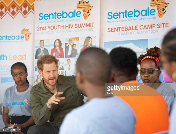 Prince Harry Duke of Sussex joins in a confidence building exercise with young people during a visit to the Kasane Health Post run by the Sentebale...