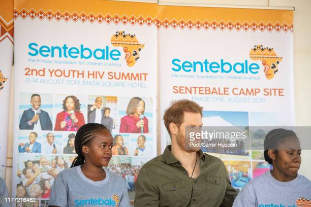 Prince Harry Duke of Sussex joins in a confidence building exercise with young people at the Kasane Health Post run by the Sentebale charity on...