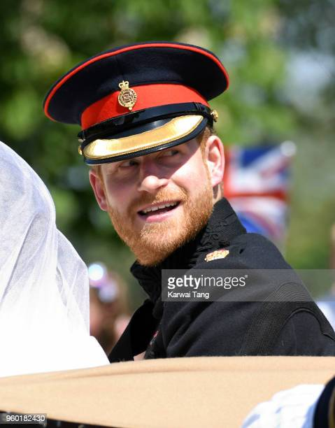 Prince Harry Duke of Sussex leaves Windsor Castle in the Ascot Landau carriage during a procession after getting married at St Georges Chapel on May...