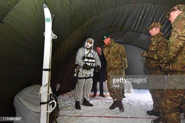 Prince Harry Duke of Sussex looking at equipment during a visit to Exercise Clockwork in Bardufoss Norway for a celebration of the 50th anniversary...
