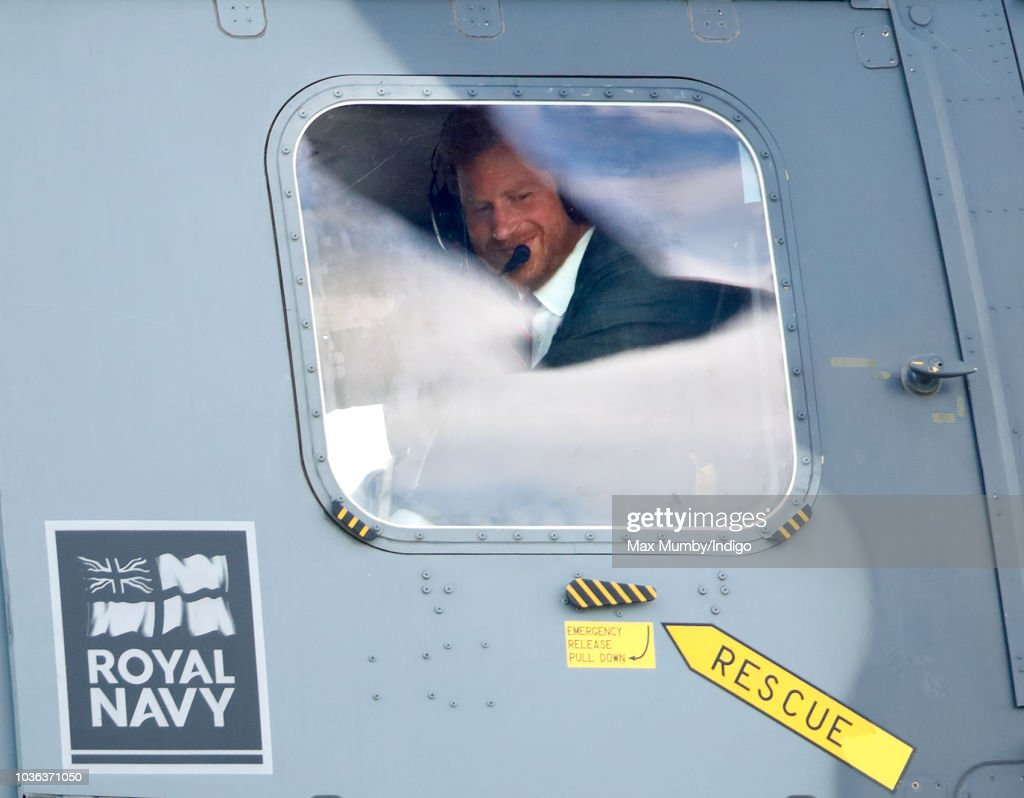 Prince Harry, Duke of Sussex looks out of the window of a Royal Navy Wildcat Maritime Attack Helicopter as departs The Royal Marines Commando Training Centre on September 13, 2018 in Lympstone, England. The Duke arrived at the centre in a Royal Navy Wildcat Maritime Attack Helicopter for his first visit in his role as Captain General Royal Marines. He met with new recruits undergoing training as well as the Invictus Games Racing Team.