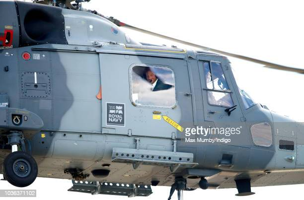 Prince Harry Duke of Sussex looks out of the window of a Royal Navy Wildcat Maritime Attack Helicopter as departs The Royal Marines Commando Training...
